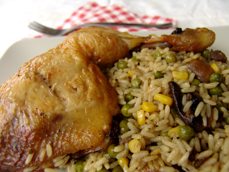 Roast chicken with rice, peas, corn and mushrooms