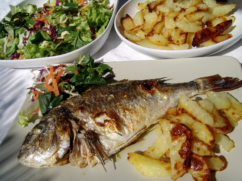 grilled sea bream cooking in plain greek