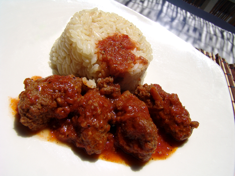 Meat balls in tomato sauce with rice (Soutzoukakia Smyrneika)