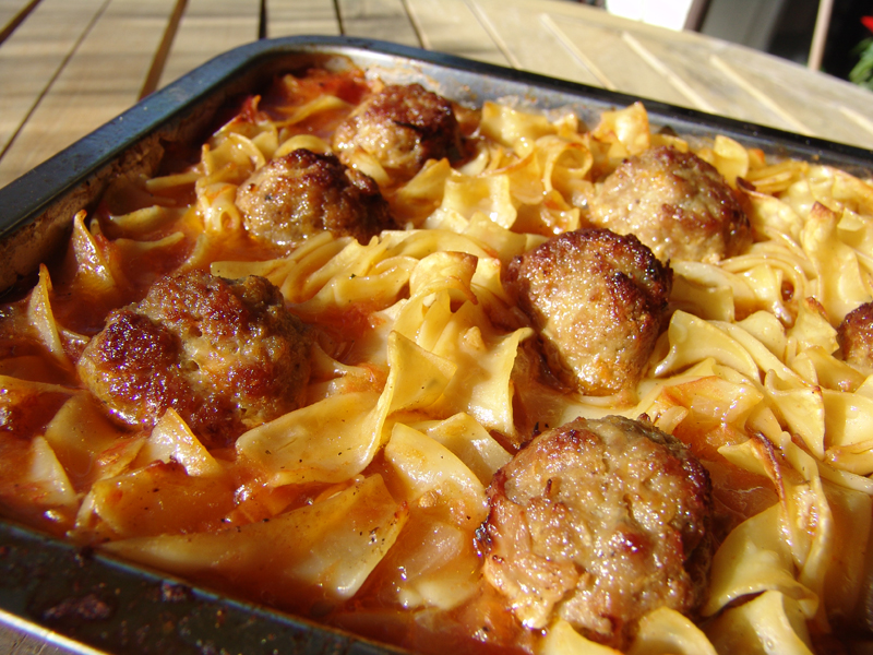 Meat balls with Greek noodles in tomato sauce
