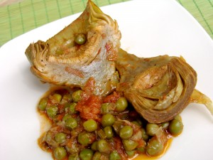 Artichokes with green peas in tomato sauce