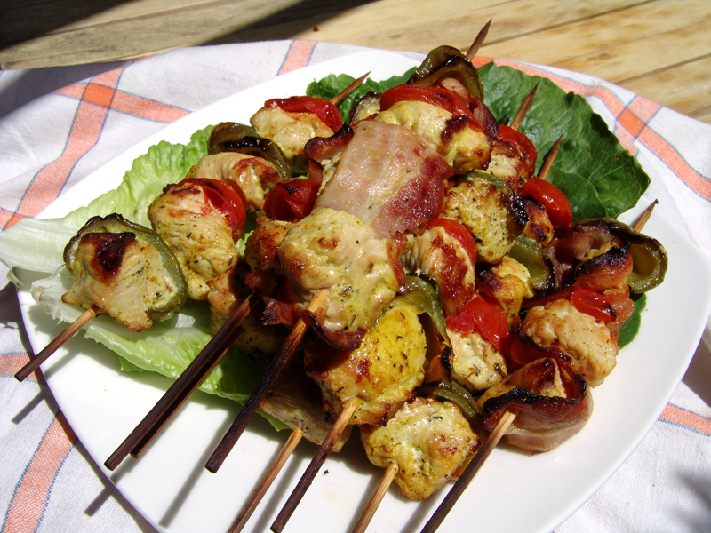 Spicy skewered turkey and cherry tomatoes