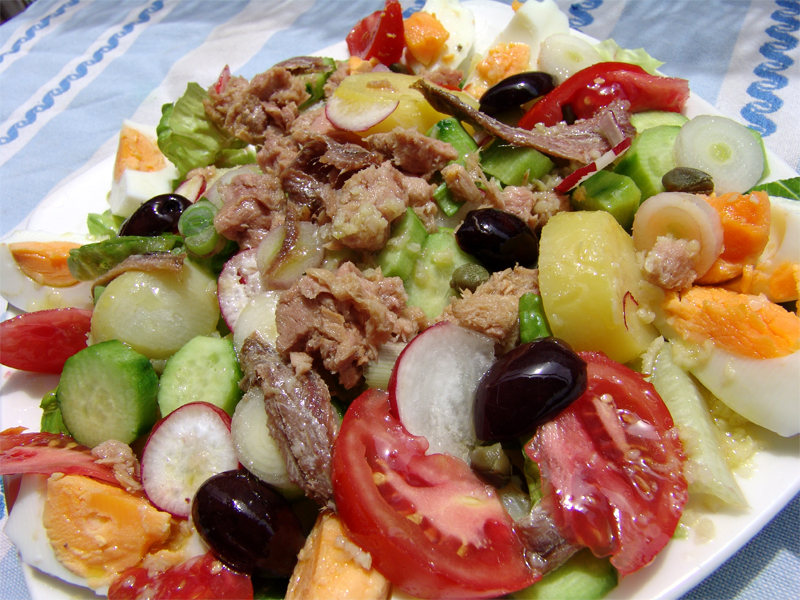 Potato salad with tuna fish and anchovy fillets