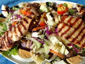 Mixed salad with broiled chicken breasts